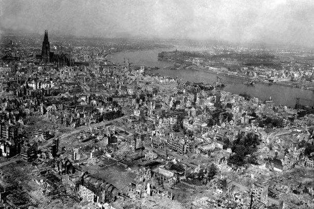 Cologne Cathedral stands undamaged while entire area surrounding it is completely devastated. Railroad station and Hohenzollern Bridge lie damaged to the north and east of the cathedral. Germany, April 24, 1945. T4c. Jack Clemmer. (Army) NARA FILE #: 111-SC-206174 WAR & CONFLICT BOOK #: 1337